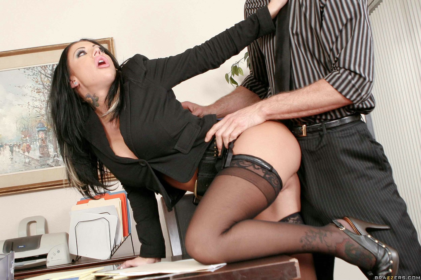 Girl bent over desk